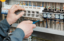 Electrician fitting a fuse box