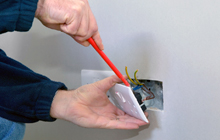 Electrician fitting a plug socket